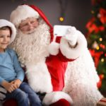 kid sitting on santa