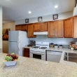 """""""Enjoy having a bright, airy, and newly renovated kitchen that offers a full set of appliances and plenty of cabinet space."""""""